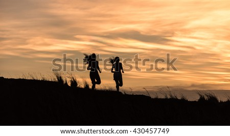 Young fitness woman running on sunrise #430457749