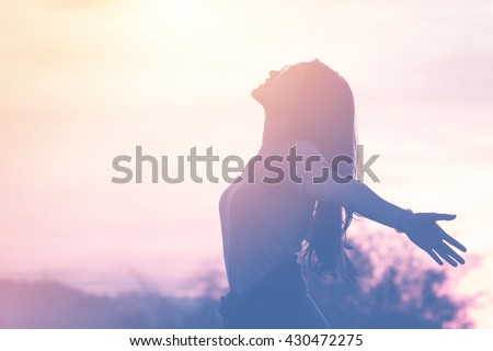 Young woman relaxing in summer sunset sky outdoor. People freedom style. Royalty-Free Stock Photo #430472275