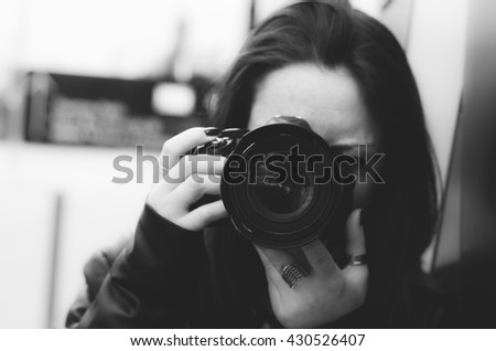 Girl taking photo using her reflex. Black and white photography. #430526407