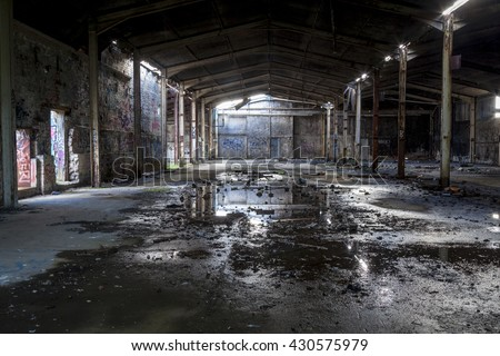 Disused, derelict and abandoned industrial warehouse. Royalty-Free Stock Photo #430575979