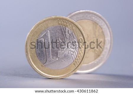 Standing coins one euro and two euro isolated on the gray background #430611862
