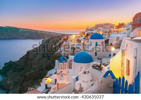 Picturesque view, Old Town of Oia or Ia on the island Santorini, white houses and church with blue domes at sunset, Greece #430635037