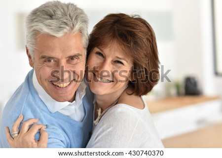 Portrait of smiling senior couple at home #430740370