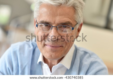 Portrait of senior man with eyeglasses #430740385