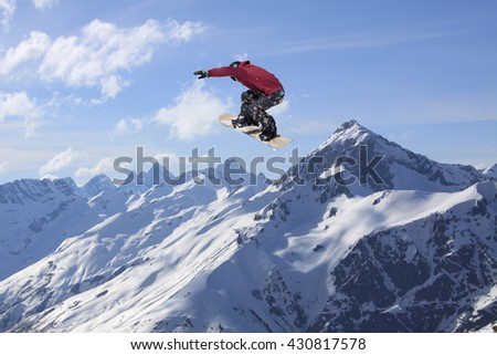 Snowboard rider jumping on mountains. Extreme snowboard freeride sport. #430817578