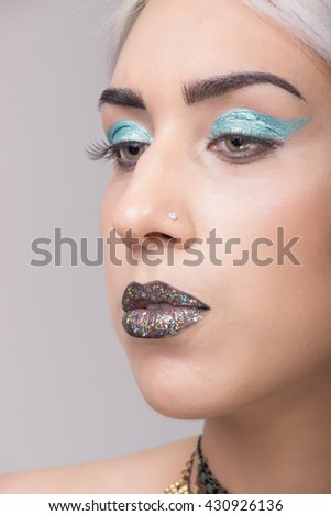 Young adult model Girl portrait eccentric style, shiny lips blue eyeshadow platinum hair. #430926136