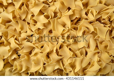 Overhead view of wide egg noodles as a background #431146111