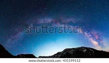 Milky Way galaxy, over mountain peaks with snow #431199112