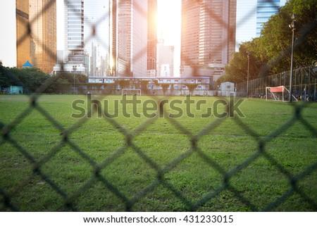 football field in modern city #431233015