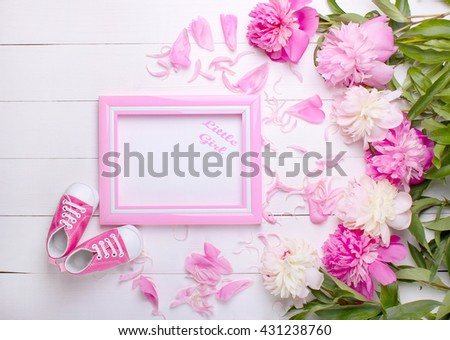 baby's bootees with a frame on a white background #431238760