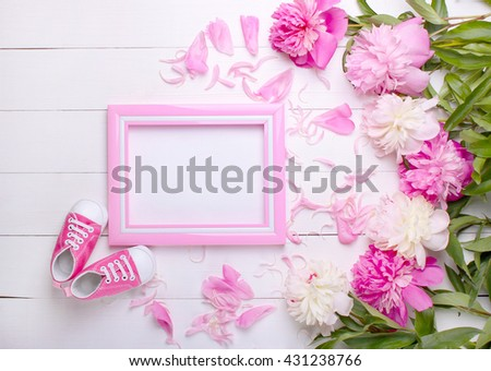 baby's bootees with a frame on a white background #431238766