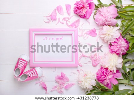 baby's bootees with a frame on a white background #431238778