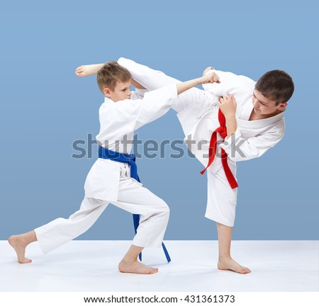 Two athletes are beating blows arm and kick leg #431361373