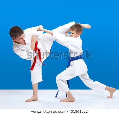 Two athletes are beating blows arm and kick leg #431361382