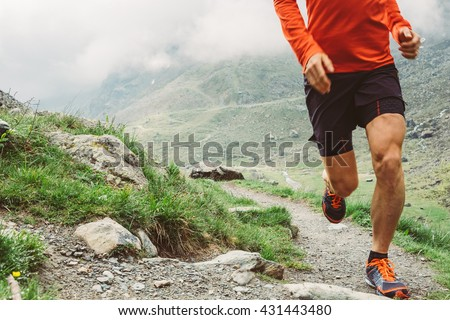 Man trail running in the mountain Royalty-Free Stock Photo #431443480