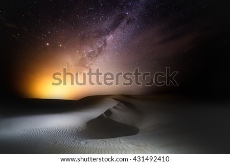 As the milky way ascends over the night sky, like it was born from a burning light.