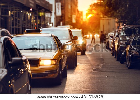Car traffic on New York City street at sunset time #431506828