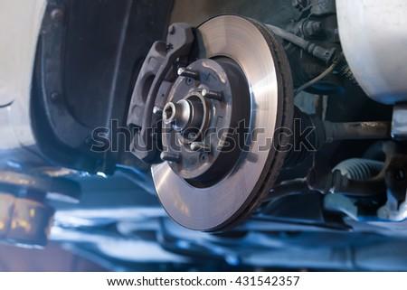 Car brake disc without wheels closeup Royalty-Free Stock Photo #431542357