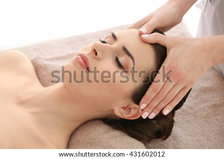 Young woman having massage in spa salon #431602012