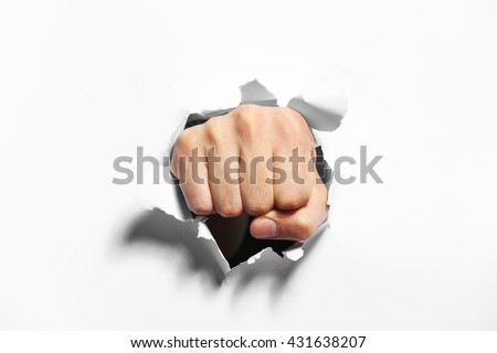 Male fist punching through paper, isolated on white Royalty-Free Stock Photo #431638207