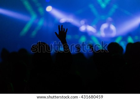 Night life Rock concert, silhouettes of happy people raising up hands #431680459