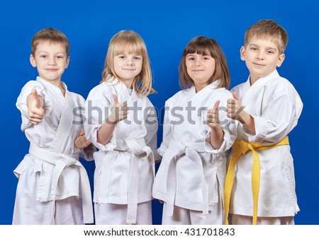 Four cheerful child standing in a white kimono on a blue background  #431701843