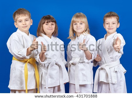 Four cheerful child standing in a white kimono on a blue background  #431701888