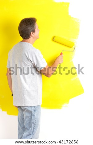 Smiling handsome man painting interior wall of home. #43172656