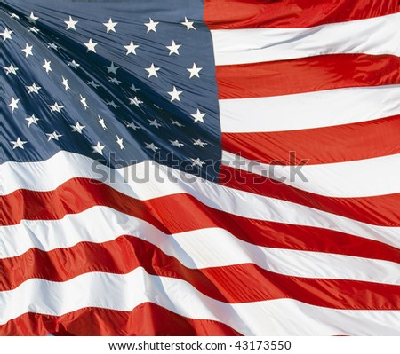Photo of American flag waving in the wind #43173550