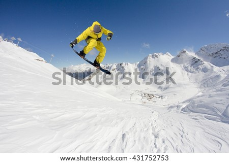 Snowboard rider jumping on mountains. Extreme snowboard freeride sport. #431752753
