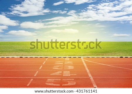 Start and Finish point of race track ,Running track number in front of tracks in stadium with beautiful green grass with blue sky scenery  background #431761141