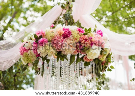 Wedding decoration ceremony (Chandelier in the arch of flowers) #431889940
