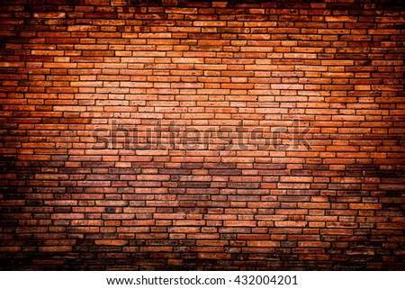 brick weathered stained old brick wall background red brick wall texture grunge background with vignetted corners, may use to interior design #432004201