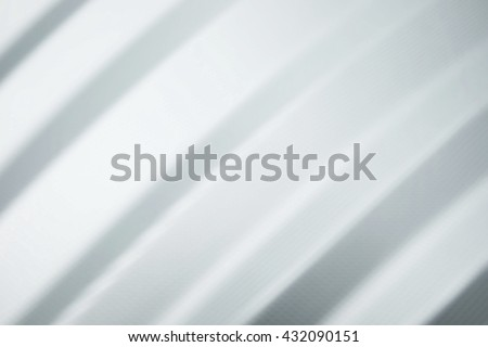 Blurred background of baggage surface, soft white shiny metallic with lines. #432090151