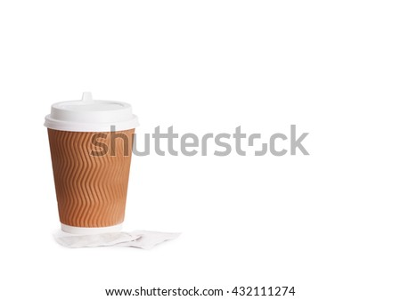Disposable cup of coffee in hand and sticks with sugar #432111274