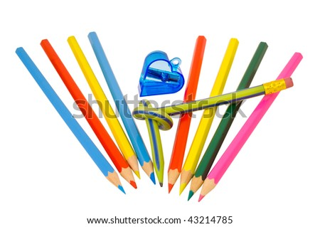 A close up of the colored pencils and sharpener. Isolated on white. #43214785