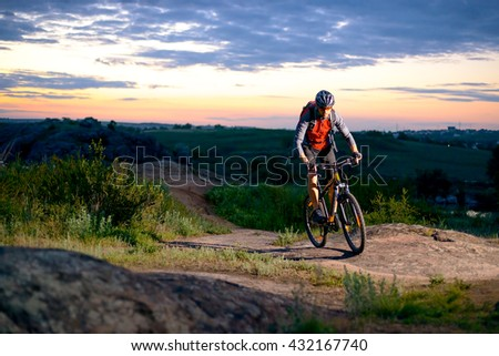 Cyclist Riding the Bike on the Mountain Rocky Trail at Sunset. Extreme Sports #432167740