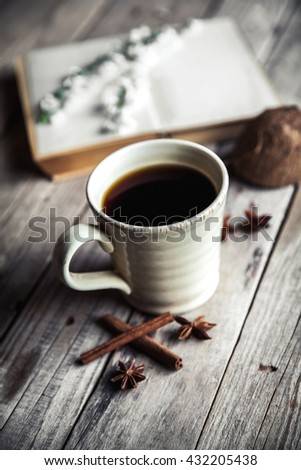 Large Cup of coffee on vintage wooden background. Spring flowers and books. #432205438