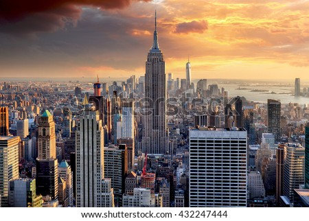New York skyline at sunset, USA. Royalty-Free Stock Photo #432247444