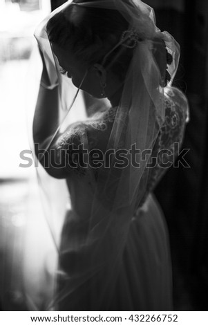 young woman pulls a long white veil #432266752