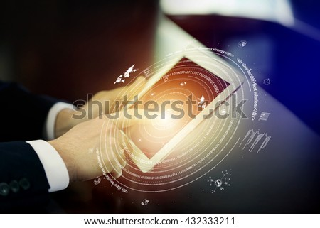 Man using tablet against high tech background #432333211