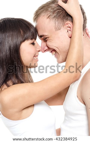 Couple. Beautiful couple over white background. Happy young family. #432384925