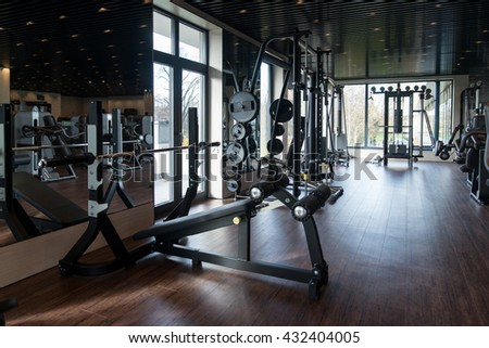 Equipment And Machines At The Modern Gym Room Fitness Center #432404005