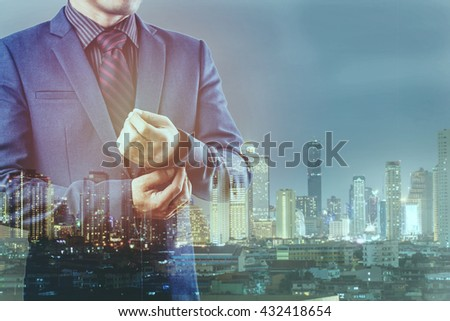 Double exposure of businessman and city #432418654