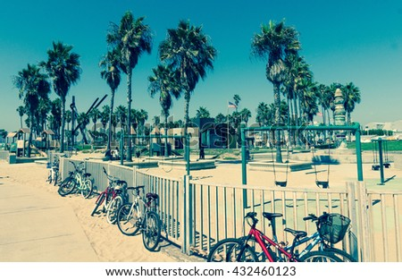 Bikes and playground at Venice Beach in Los Angeles, California - Picture cross processed in vintage style