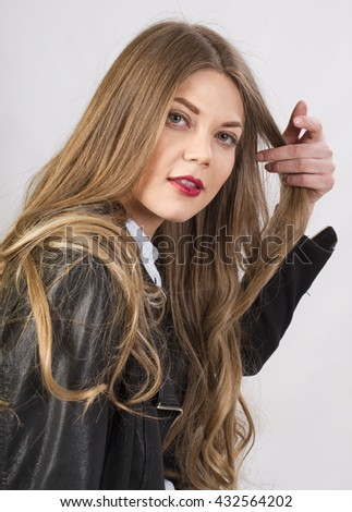 stylish attractive girl with long beautiful hair in studio #432564202