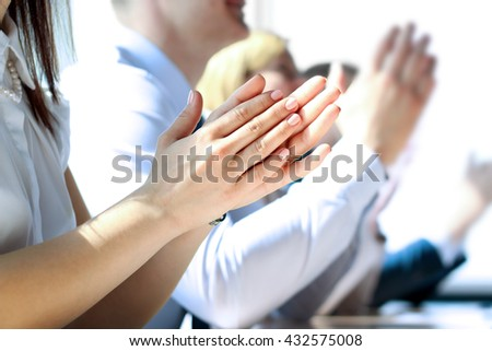 Close-up of business people clapping hands. Business seminar concept #432575008