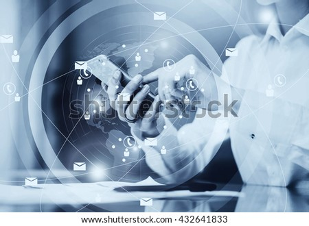 Picture business woman wearing white shirt, sending message smartphone.Open space loft office.Documents,blurred background.Connections world wide interfaces.Horizontal,black and white