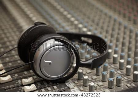 headphones on old dirty sound mixer panel
