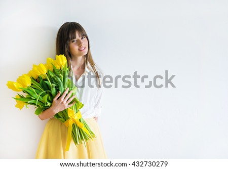 image of cute woman with bouquet